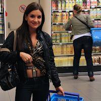 Bella in a crowded supermarket