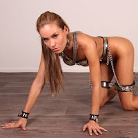 Sylvie in full chastity outfit