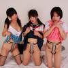 Three cosplay girls belted